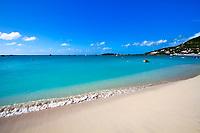 Paradisiac beach, turquoise water, and sailing boats under a blue sky, in the beautiful Sint Maarten (Saint Martin), Caribbean Leeward Islands