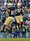 Oct. 29, 2011; Center Braxston Cave and safety Harrison Smith celebrate during the Navy game. ..Photo by Matt Cashore