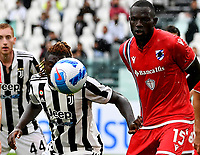 Calcio, Serie A: Juventus vs Sampdoria Allianz stadium, Turin, September 26, 2021.<br /> Juventus' Moise Kean (L) in action with Sampdoria's Omar Colley  (R) during the Italian Serie A football match between Juventus and Sampdoria  at Allianz stadium, Turin, on September 26, 2021.<br /> UPDATE IMAGES PRESS/Isabella  Bonotto