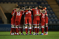 Crawley players huddle during Colchester United vs Crawley Town, Sky Bet EFL League 2 Football at the JobServe Community Stadium on 1st December 2020