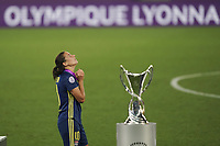 30th August 2020, San Sebastien, Spain;  Dzsenifer Marozsan of Lyon with winners medal passes trophy after winning the UEFA Womens Champions League football match Final between VfL Wolfsburg and Olympique Lyonnais 3-1