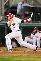 Brandon Miller (20) of the Hagerstown Suns follows through on his swing against the Delmarva Shorebirds at Municipal Stadium on April 11, 2013 in Hagerstown, Maryland.  The Shorebirds defeated the Suns 7-4.  (Brian Westerholt/Four Seam Images)