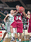 Troy Trojans forward Ray Chambers (34) and North Texas Mean Green forward Tony Mitchell (13) in action during the game between the Troy Trojans and the University of North Texas Mean Green at the North Texas Coliseum,the Super Pit, in Denton, Texas. UNT defeats Troy 87 to 65.....