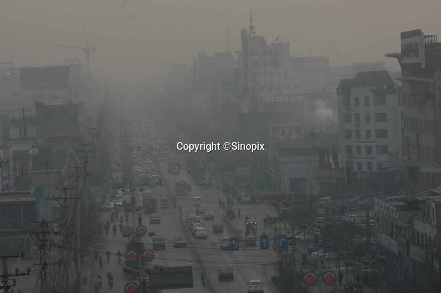 The Linfen city centre, Shanxi Province, China. Linfen is reportedly the most polluted city in China and at the heart of the coal mining industry. China produces around 2.4 billion tones of coal annually that contributes to more than 400,000 premature deaths annually due to air pollution, acid rain and poisonous ground water. It also contributes to global warming...PHOTO BY SINOPIX