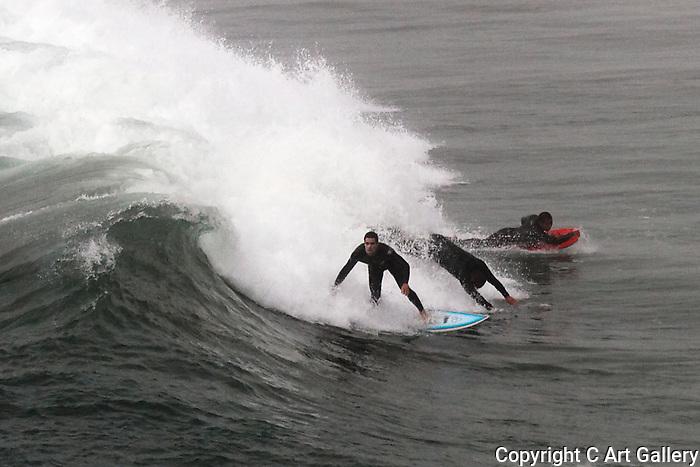 Surfing Huntington Beach, Surfing Southern California. Photograph by Alan Mahood.