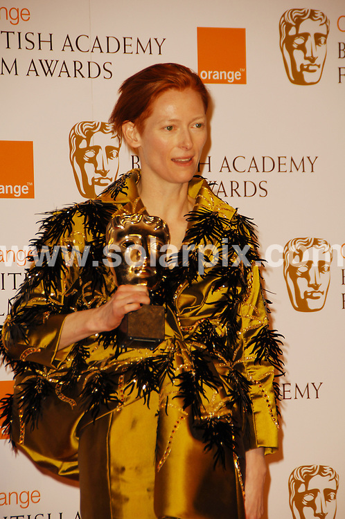 **ALL ROUND PICTURES FROM SOLARPIX.COM**.**WORLDWIDE SYNDICATION RIGHTS**.The Orange British Academy Film Awards.Royal Opera House, London, February 10th 2008   ..This pic: Tilda Swinton..JOB REF: 5750 MSR    DATE: 08_02_2008.**MUST CREDIT SOLARPIX.COM OR DOUBLE FEE WILL BE CHARGED* *UNDER NO CIRCUMSTANCES IS THIS IMAGE TO BE REPRODUCED FOR ANY ONLINE EDITION WITHOUT PRIOR PERMISSION*