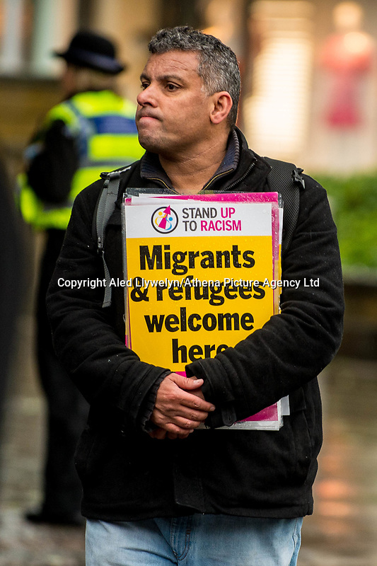Monday 05 June 2017<br /> Pictured: A man holds a sign reading ' migrants and refugees welcome here' <br /> Re: A vigil has been held in Swansea City Centre to remember the victims of the recent terror attack in London. Stand up to Racism Swansea have organised the event alongside Swansea Coalition Against War and Swansea People's Assembly.