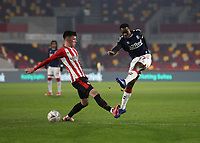 9th January 2021; Brentford Community Stadium, London, England; English FA Cup Football, Brentford FC versus Middlesbrough; Marc Bola of Middlesbrough taking a shot past Alex Gilbert of Brentford
