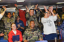 THE FRENCH CELEBRATE AT THE END OF THE RUGBY WORLD CUP QUARTER FINAL BETWEEN FRANCE AND ENGLAND ON THE HMS BULWARK WHILST ON A BREAK FROM A JOINT EXERCISE IN LOCH EWE AND OFF THE SCOTTISH ATLANTIC COAST