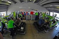 The #75 & #76 Krohn Racing Pontiac/Rileys in the garage.