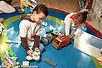 Education preschool 3-4 year olds boy and girl playing separately with plastic toy vehicle and airplane horizontal, boy talking to himself