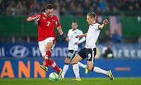 VIENNA, Austria - November 19, 2013: Aron Johannsson and Austria's Marko Arnautovic during a 0-1 loss to host Austria during the international friendly match between Austria and the USA at Ernst-Happel-Stadium.