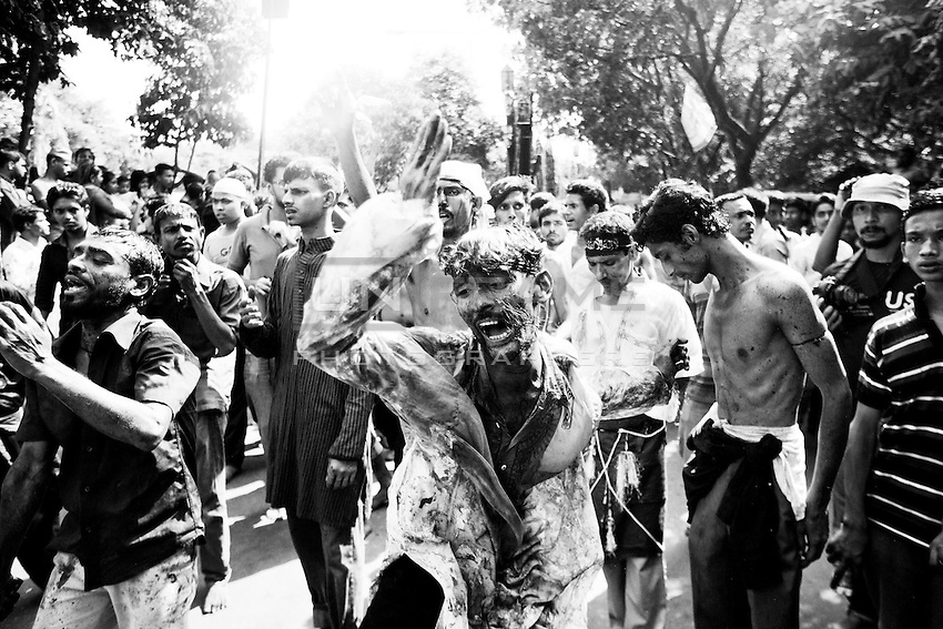 Bangladeshi Shiite flagellates themselves with chains and knives during the holy day of Ashura. Shiites mark Ashura, the tenth day of the month of Muharram, to commemorate the Battle of Karbala when Imam Hussein, a grandson of Prophet Muhammad, was killed. Dhaka, Bangladesh. Nov. 3, 2014