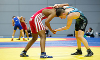 11 MAY 2014 - SHEFFIELD, GBR - Bobby Singh (left) and Ryan Kay (right) each attempt to take control during their freestyle match at the British 2014 Senior Wrestling Championships in EIS in Sheffield, Great Britain  (PHOTO COPYRIGHT © 2014 NIGEL FARROW, ALL RIGHTS RESERVED)