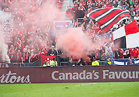 Toronto, Ontario - April 12, 2014: The Toronto FC fans set off a smoke flare during the 2nd half in a game between the Colorado Rapids and Toronto FC at BMO Field in Toronto.<br />