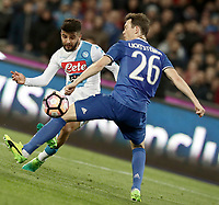 Calcio, Serie A: Napoli, stadio San Paolo, 2 aprile, 2017.<br /> Napoli's Lorenzo Insigne (l) in action with Juventus Stephan Lichtsteiner (r) during the Italian Serie A football match between Napoli and Juventus at San Paolo stadium, April 2, 2017<br /> UPDATE IMAGES PRESS/Isabella Bonotto