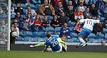 Gavin Reilly strokes the ball past Rangers keeper Steve Simonsen to score for QoS
