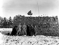 The pathfinder unit of the 101st Airborne Div., dropped by parachute, sets up radar equipment near Bastogne, Belgium.  It is their job to guide planes with medical supplies and ammunition to the division, besieged by the Germans.  December 23, 1944.  T5c. Krochka. (Army)<br /> NARA FILE #:  111-SC-222396<br /> WAR & CONFLICT BOOK #:  1072