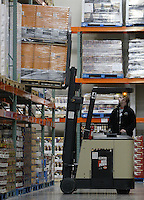 Shaun Herr lifts pallets of inventory to a shelf at a Costco Wholesale Warehouse Friday, March 9, 2007 in Columbus, Ohio.