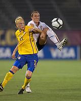 US defender Meghan Schnur (17) and Sweden forward Linnea Liljegard (11) battle for a ball. The US Women's national team beat Sweden, 3-0, at Rentschler Field on July 17, 2010.