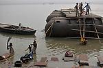 Indian people using the water of Ganga for domestic purposes. Varanasi, Uttar Pradesh, India. On an avarage daily 50,000 people uses the water of Ganga for domestic use in the city of Varanasi.