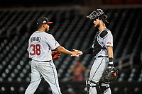 Scottsdale Scorpions catcher Joey Bart (27) congratulates Daysbel Hernandez (38) after an Arizona Fall League game against the Mesa Solar Sox on September 18, 2019 at Sloan Park in Mesa, Arizona. Scottsdale defeated Mesa 5-4. (Zachary Lucy/Four Seam Images)