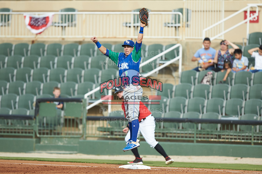 Lexington Legends first baseman Brhet Bewley (1) jumps for a high throw during the game against the Kannapolis Intimidators at Kannapolis Intimidators Stadium on August 4, 2019 in Kannapolis, North Carolina. The Legends defeated the Intimidators 5-1. (Brian Westerholt/Four Seam Images)