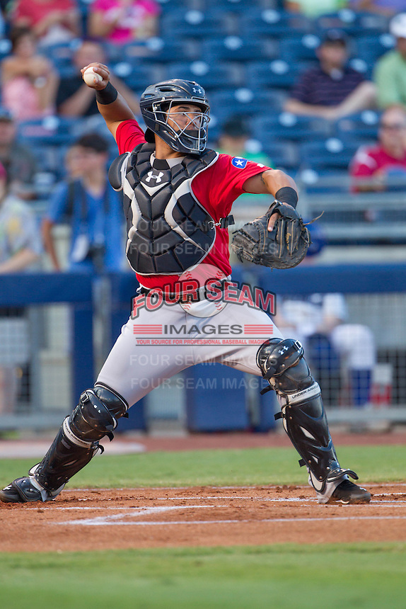 Frisco RoughRiders catcher Jorge Alfaro (8) throws to second base to head off an attempted steal during the Texas League game against the Tulsa Drillers at ONEOK field on August 15, 2014 in Tulsa, Oklahoma  The RoughRiders defeated the Drillers 8-2.  (William Purnell/Four Seam Images)
