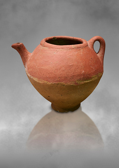 Assyrian Traders terra cotta imported teapot with side spout . 1900 - 1600 BC. Çorum Archaeological Museum, Corum, Turkey. Against a grey bacground.