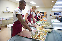 San Francisco, California - January 7, 2010: Kraft Fight Hunger Bowl players from Nevada and Boston College serve meals in San Francisco, California.