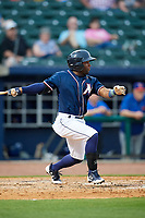 Northwest Arkansas Naturals second baseman Ruben Sosa (4) follows through on a swing during a game against the Midland RockHounds on May 27, 2017 at Arvest Ballpark in Springdale, Arkansas.  NW Arkansas defeated Midland 3-2.  (Mike Janes/Four Seam Images)