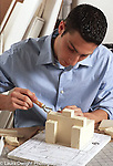 Internship program for college students at major architectural firm, young man working on clay model