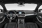 Stock photo of straight dashboard view of 2021 BMW 3-Series-Touring-PHEV M-Sport 5 Door Wagon Dashboard