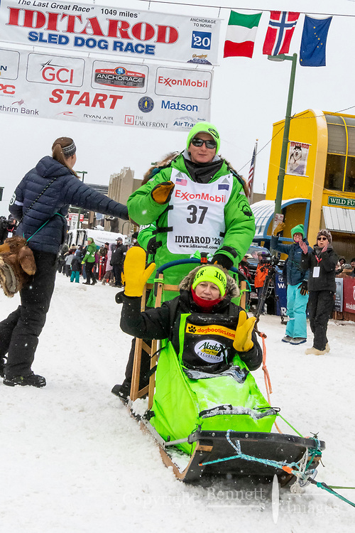 xxx xx and team leave the ceremonial start line with an Iditarider and handler at 4th Avenue and D street in downtown Anchorage, Alaska on Saturday March 7th during the 2020 Iditarod race. Photo copyright by Cathy Hart Photography.com
