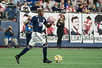 FOXBOROUGH, MA - SEPTEMBER 29: Luis Caicedo #27 of New England Revolution brings the ball forward during a game between New York City FC and New England Revolution at Gillettes Stadium on September 29, 2019 in Foxborough, Massachusetts.