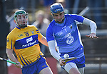 Cathal McInerney of Clare  in action against Stephen O'Keeffe of Waterford during their National League game at Cusack Park. Photograph by John Kelly.