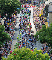 The Tour de France cyclists make their way up Skipton High Street on the first day of the tour.5th July 2014. Picture Jonathan Gawthorpe/YPN. COPYRIGHT WARNING : THIS IMAGE IS RIGHTS MANAGED AND THE COPYRIGHT MAY SIT WITH A THIRD PARTY PLEASE CONTACT simon@swpix.com BEFORE DOWNLOAD AND OR USE