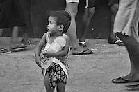 Boy holding a water bottle, Cebu, Philippines
