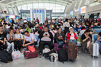Passengers in Xining railway station, one of the main stops on the train journey that runs into Tibet and onto Lhasa.