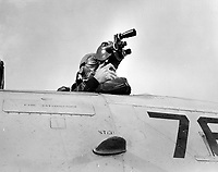 Model Q Eyemo camera in action at NAS Pensacola, Florida.  An Eyemo motion picture camera in an SNJ, plane of the Photo Squadron.