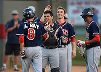 Lake Brantley Patriots catcher Luis Olivier (24) congratulates Alex Ray (8) after scoring a run with Paxton Rigby (22) during a game against the Lake Mary Rams on April 2, 2015 at Allen Tuttle Field in Lake Mary, Florida.  Lake Brantley defeated Lake Mary 10-5.  (Mike Janes/Four Seam Images)