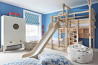 A loft bed/ climbing frame complete with slide and rope swing