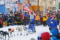 Martin Buser coming down the finish chute in Nome to win the 2002 Iditarod in record time