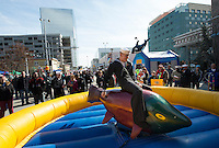 130501-N-DR144-057 ANCHORAGE, Alaska (May 1, 2013)- Sailors assigned to San Antonio-class amphibious transport dock ship USS Anchorage (LPD 23) take turns riding a mechanical salmon at the Dock on the Block party in downtown Anchorage. The city of Anchorage and various sponsors provided free food, rides and entertainment for Sailors and their families along 6th Avenue. Anchorage is currently moored in its namesake city of Anchorage, Alaska for its commissioning ceremony scheduled to take place May 4. (U.S. Navy photo by Mass Communication Specialist 1st Class James R. Evans / RELEASED)