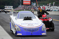 Oct. 1, 2011; Mohnton, PA, USA: NHRA funny car driver Leah Pruett is pushed off the track by an official on a quad during qualifying for the Auto Plus Nationals at Maple Grove Raceway. Mandatory Credit: Mark J. Rebilas-