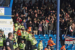 """Portsmouth 1 Southampton 1, 18/12/2012. Fratton Park, Championship. Visiting Southampton fans reacting with delight as their team take the lead during the second half of their Championship fixture against Portsmouth at Fratton Park stadium. Around 3000 away fans were taken directly to the game in a fleet of buses in a police operation known as the """"coach bubble"""" to avoid the possibility of disorder between rival fans. The match ended in a one-all draw watched by a near capacity crowd of 19,879. Photo by Colin McPherson."""