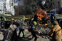 Rioters hail paving stones beyond the barricades. Kiev, Ukraine