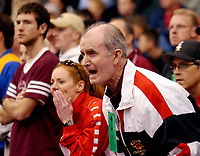 Arkansas Democrat-Gazette/ BETH CLAGGETT<br />John McDonnell coaches a runner during the NCAA Indoor Track and Field Championship in Fayetteville.<br />3/9/02