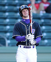 Catcher Paul Nitto (18) of the Furman Paladins in a game against the Michigan State Spartans on February 25, 2012, at Fluor Field in Greenville, South Carolina. (Tom Priddy/Four Seam Images)