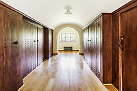 BNPS.co.uk (01202 558833)<br /> Pic: Hamptons/BNPS<br /> <br /> Pictured: A hallway.<br /> <br /> An incredible Arts and Crafts country house with its own vineyard is on the market for offers over £7m.<br /> <br /> The Grade II listed St Joseph's Hall is a striking 111-year-old property that was home to the Bishop of Arundel for 40 years.<br /> <br /> It has a wealth of period features, an indoor swimming pool and seven acres of vineyard with mostly Chardonnay grapes, which the owners sell to a local winery.<br /> <br /> The house in Storrington, West Sussex, has 17 acres of land with beautiful views over the South Downs.